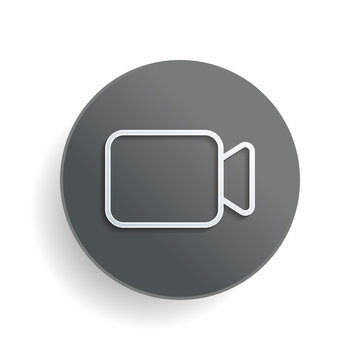 Video camera icon. Linear, thin outline. White paper symbol on gray round button or badge with shadow