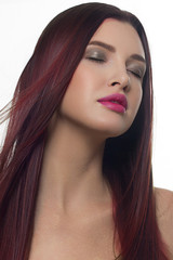 Close-up beauty portrait of a woman with long purple hair and violet lipstick on lips. Lamination and hair coloring, day and evening makeup. Facial skin care in the spa salon and cosmetology