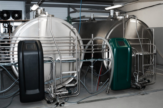 Milk cooling tank with horizontal storage. Storing and cooling milk in dairy farming.
