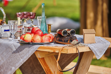 Still life of apples, glasses and old royal binoculars