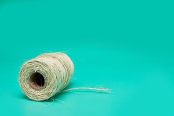 Cord. packing tape roll, green background