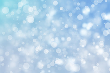 Shiny blue bokeh blur background. Glowing glitter circle particles holiday.
