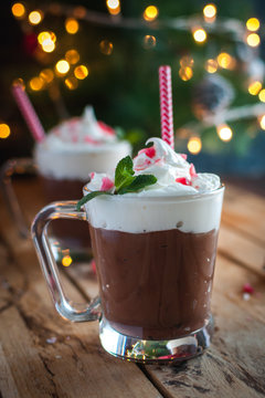 Close-up of Christmas mint hot chocolate on wooden background
