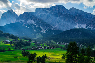 Scenic landscape panoramic view of Cortina D´Ampezzo and Tofana mountains, highest peaks in Dolomites, Italy. Popular tourist destination/attraction for active family holiday. Summer warm colours