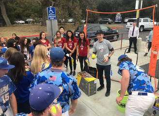 U.S. Olympic freestyle skier David Wise presents new sports equipment to students from Agoura High School, in Agoura Hills, California