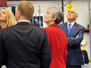 U.S. Vice President Mike Pence looks over the Dragon crew capsule inside the SpaceX hangar at Launch Complex 39-A, where the space ship and Falcon 9 booster rocket are being prepared for a January 2019 launch at Cape Canaveral