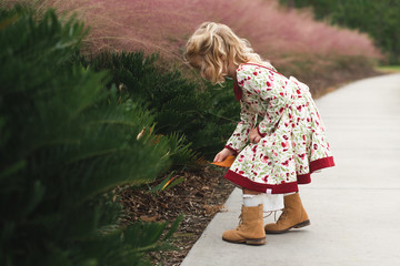 Young girl holding a leaf