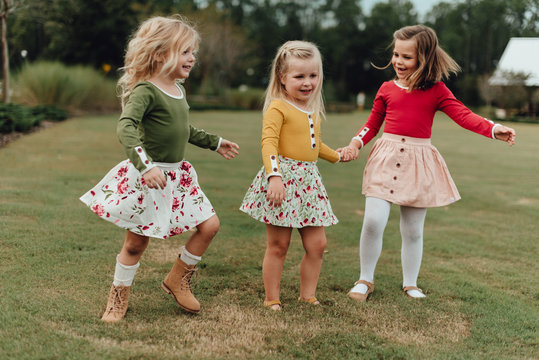 Three young girls playing