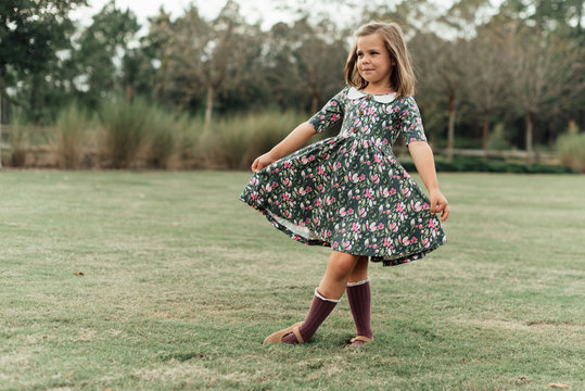 Young girl posing in a floral dress