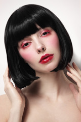 Young beautiful woman with fancy make-up and bob haircut