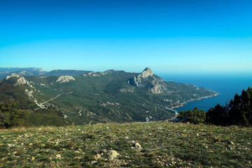 Scenery of South Coast of Crimea, endless Black Sea and rocky cliffs, Russia