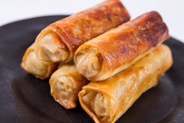 Chinese Traditional Spring rolls on a black plate