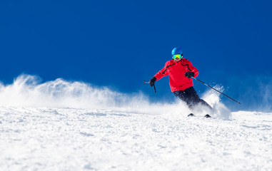 Garden Poster Winter sports Man skiing on the prepared slope with fresh new powder snow