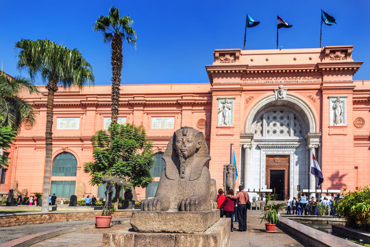 Cairo, Egypt - Nov 2nd 2018 - Tourists in front of the main entrance of the Egypt history museum in Cairo in a blue sky day