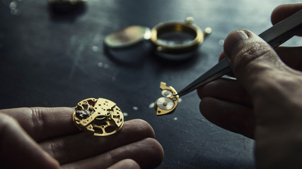 Watch maker is repairing a vintage automatic watch. Wall mural