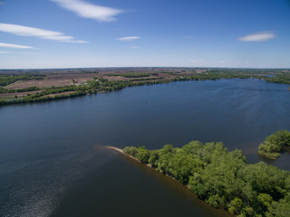 an aerial photo of a lake