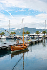 Wood boat in harbor in sea of Montenegro