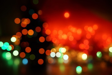 natural bokeh holiday lights background bright lights Christmas tree in the city lights