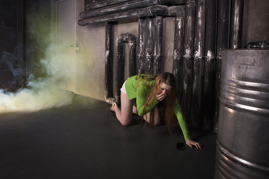 Girl suffocating from poisonous smoke