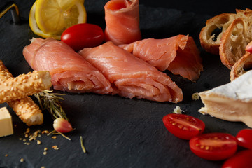salted fish with cheese tomatoes and spices
