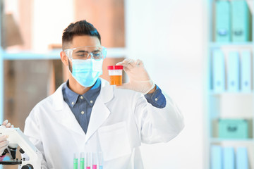 Young scientist working in laboratory. Chemical analysis