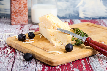 cheese and wine grapes on table