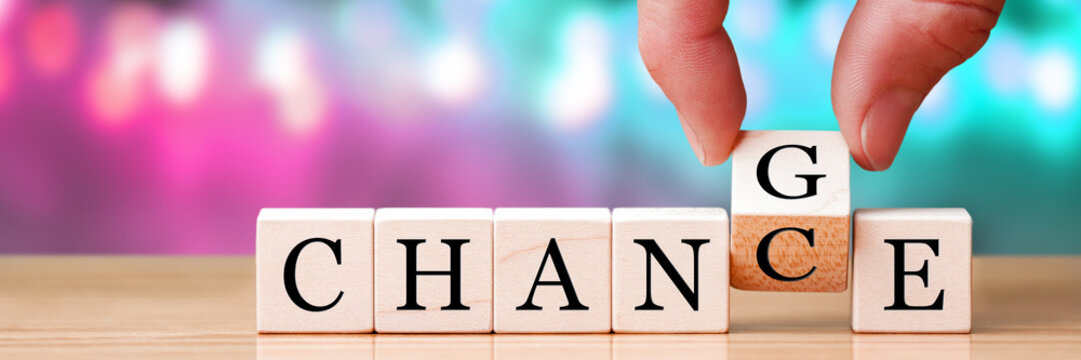 Hand Changing Word From Chance To Change On Wooden Cubes, New Years Resolution / Life Goals Concept
