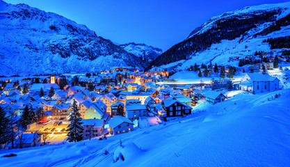 Andermatt village in Alps mountains in winter snow, Uri, Switzerland