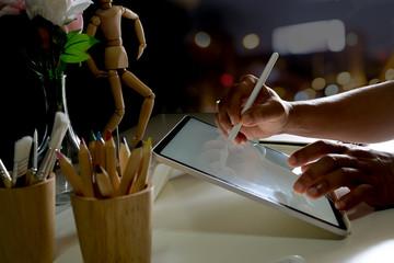 Cropped shot of designer sketch graphic drawing on digital display tablet creative  work in studio