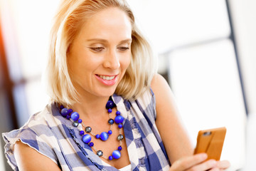 Businesswoman with mobile phone in office
