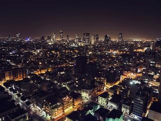 Luxury buildings in Tel Aviv Luxury residential skyscrapers in Tel Aviv. Top view of the road in the night city. night life of the metropolis