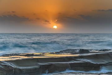 Hazy Sunrise Seascape from Rock Platform