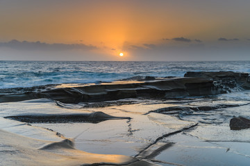 Soft Gold and Blue Hazy Sunrise Seascape from Rock Platform