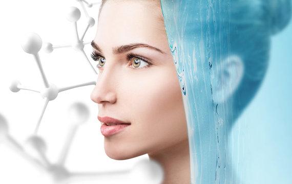 Sensual woman under water splash over white background.