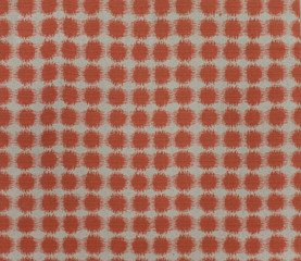 Polka dot red brown and white fabric pattern surface texture. Close-up of interior material for design decoration background