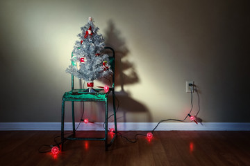 Vintage Christmas tree on an old green metal chair with vintage bubble lights