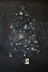 Chalk drawing of a Christmas tree with lights