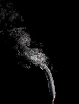 white smoke on black background