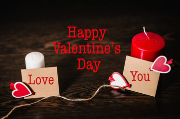 Text happy Valentine's Day. Space for text. Writing romantic letters on empty paper sheet, note for text message. Love you concept with candle. Empty greeting card with red hearts for graphic design.