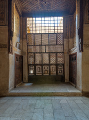 Interleaved wooden window (Mashrabiya), wooden embedded cupboards, and wooden decorated ceiling at ottoman historic Beit El Set Waseela building (Waseela Hanem House), Old Cairo, Egypt
