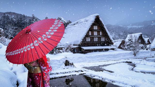 Asian woman wearing japanese traditional kimono at Shirakawa-go village in winter, UNESCO world heritage sites, Japan.