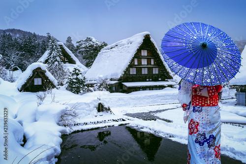Wall mural Asian woman wearing japanese traditional kimono at Shirakawa-go village in winter, UNESCO world heritage sites, Japan.