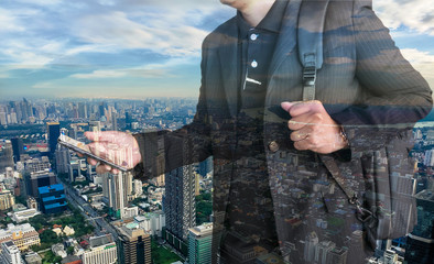 Double exposure photo of panoramic city view. Businessman looking smartphone on hand.