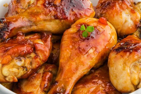 Baked glazed chicken drumsticks. Marinated in teriyaki, apricot jam, wine vinegar and corn starch sauce. Close-up