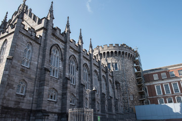 View of the side of Dublin Castle, which is one of the most famous buildings in Ireland. The architecture is Neoclassical and looks stunning. Clear blue sky is on the background.