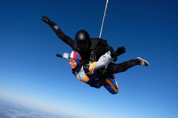 Tandem skydiving in the blue sky.