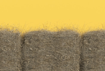 Haystack closeup isolated on yellow background with copy space. Top view. 3D render of straw.