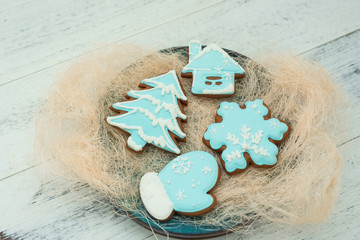 Christmas cookies with blue icing, selective focus. Winter sweets theme.
