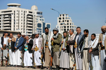 Armed Houthi followers attend a gathering to show support for their movement in Sanaa