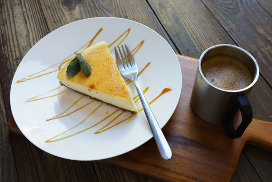 classic new york cheesecake with fork and coffee